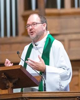 Jeff Martinhauk preaching at pulpit